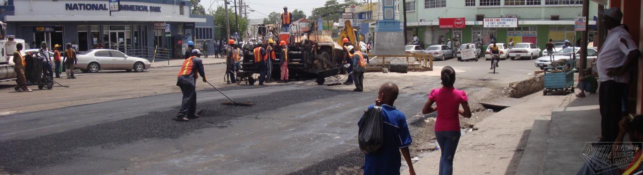 Workmen repairing road way in Old Harbour Square